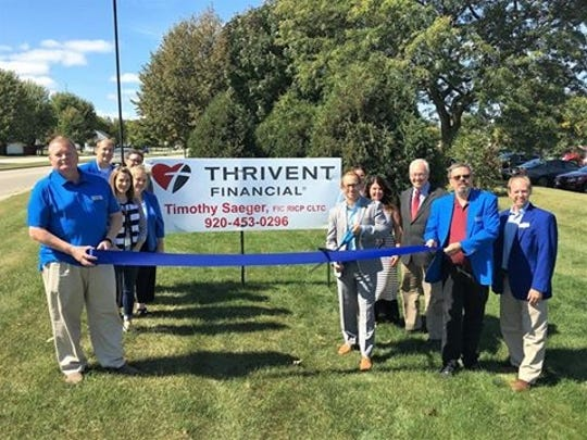 A ribbon cutting was held on Monday, September 18, to celebrate Timothy Saeger – Thrivent Financial's move to new offices at 2500 Kohler Memorial Drive. With Mayor Mike Vandersteen is Timothy Saeger, cutting the ribbon.