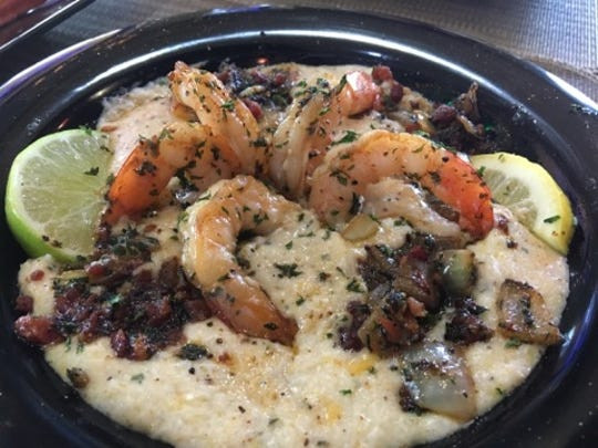 Funky Chicken's shrimp and grits special. Fivesucculent shrimp are placed in a spiral over a small blanket of melted cheese and surrounded by smoky bacon, and grilled onions.