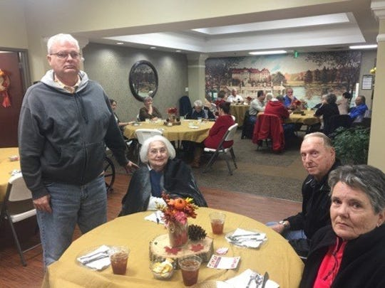 Resident Bobbye Potts and her family enjoy their time at the assited living Thanksgiving dinner.