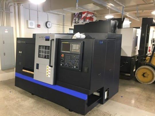 Premier Machine Tool Midwest and Hwacheon Machinery America Inc. donated a CNC lathe machine to Arrowhead High School