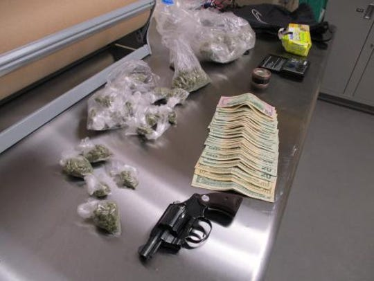 A cache of drugs, money and a loaded handgun found