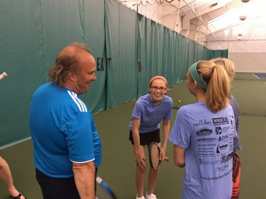 Terry Underkoffler (left) chats with Abigail Plylar (middle) and other participants of the Love for Lungs Tennis Tournament.