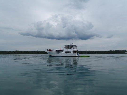 The Gemini Dream under a cloud at Presque Isle, Michigan.