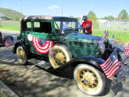 A man and his love of a car and his love of his country was an entry in last year's Smokey Bear Parade in Capitan