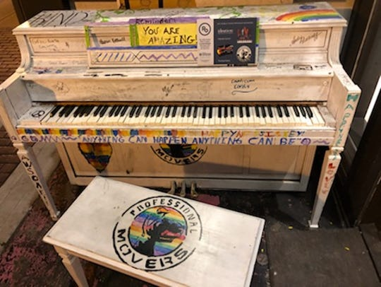 The public piano in front of Gayle's Chocolates at