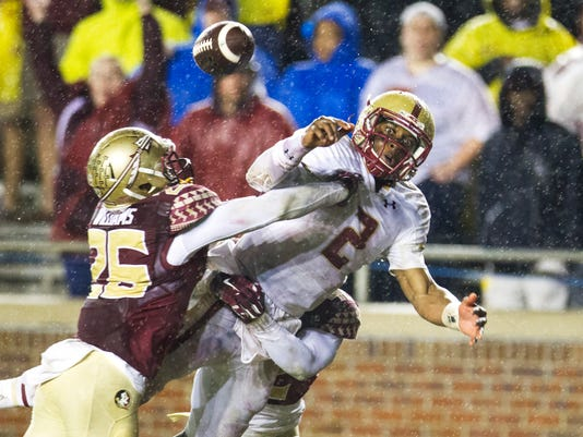 Florida State defenders P.J. Williams, left, and Lamarcus Brutus break up a pass intended for Boston College quarterback Tyler Murphy, right, in the end zone in the second half of an NCAA college football game in Tallahassee, Fla., Saturday, Nov. 22, 2014. Florida State won 20-17. (AP Photo/Mark Wallheiser)