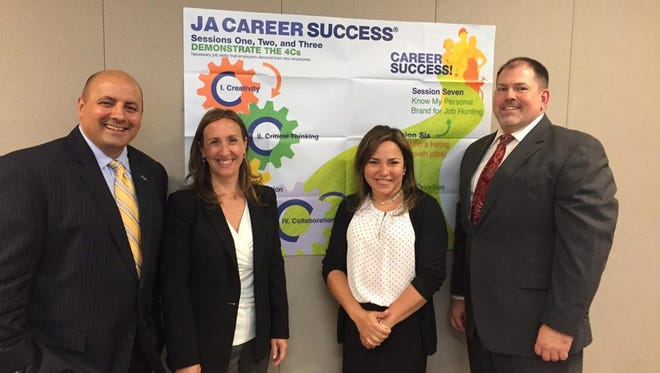 Associates at MetLife Solutions Group in the Iselin section of Woodbridge recently volunteered at Junior Achievement's Career Success workshop series at Drew University. Pictured from left to right, they are Nico Riverso, Michele Hakes, Bellaria Jimenez, and Jerry Wade.