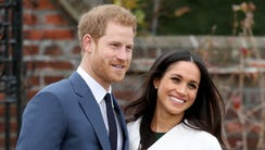 Prince Harry and Meghan Markle on day their engagement