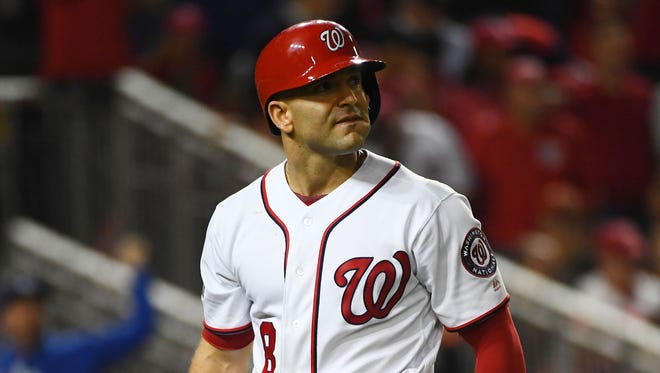 Oct 7, 2016; Washington, DC, USA; Washington Nationals shortstop Danny Espinosa (8) reacts after striking out to end the fifth inning against the Los Angeles Dodgers during game one of the 2016 NLDS playoff baseball series at Nationals Park. Mandatory Credit: Brad Mills-USA TODAY Sports