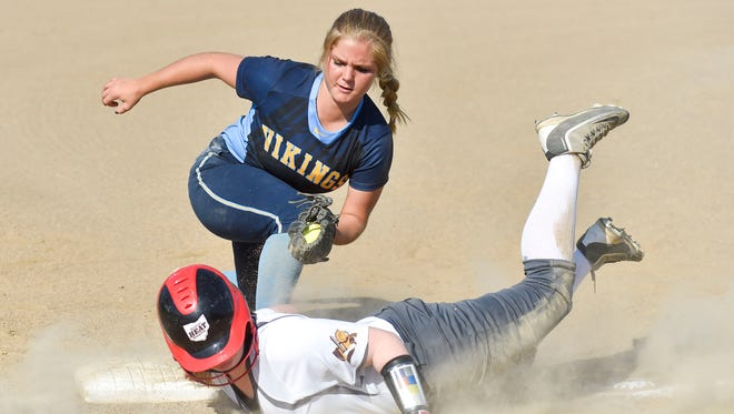 River Valley's Claire Nicholson tries to tag out Buckeye Valley's Rylee George during their Division II district semifinal game at Olentangy High School on Tuesday evening.