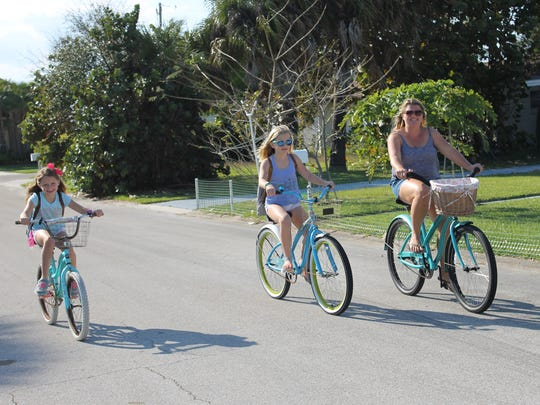 Sara DeRidder and her daughters, Susie and Betsy, ride to school together 5 days a week.