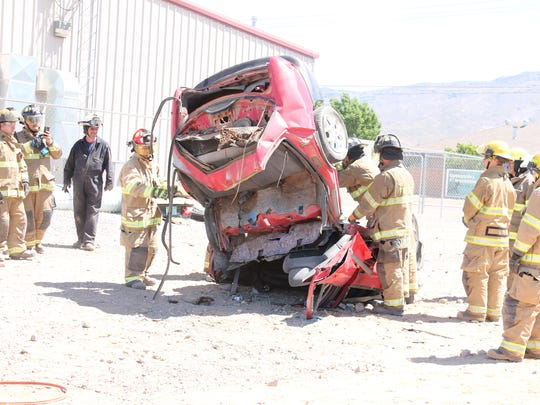 During one of their training scenarios Alamogordo firefighters rescue a victim from a car by performing a clam shell rescue.