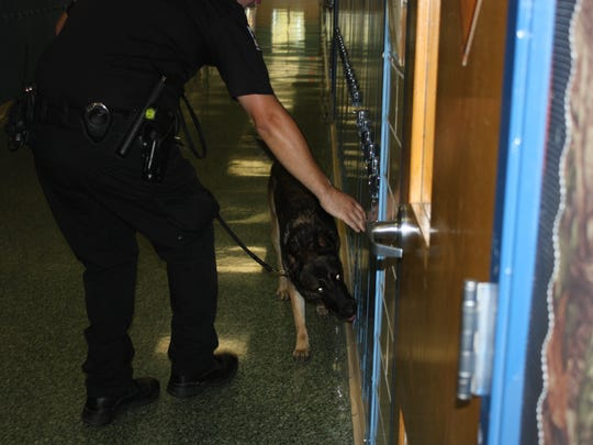 Rony, a K-9 with the Greencastle Police Department, conducts a search at a local high school. The dog has been with the department for the past seven and a half years.