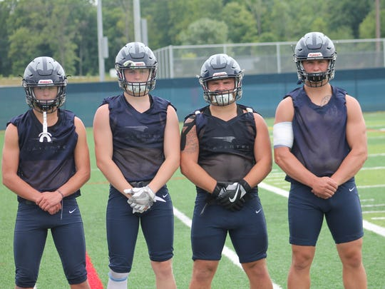 West Clermont tied Anderson and Milford for the ECC crown a year ago.  Back on the Wolves defense are (from left) Austin Price, Matt Lewis,  Max Beckman and Joe Wall.