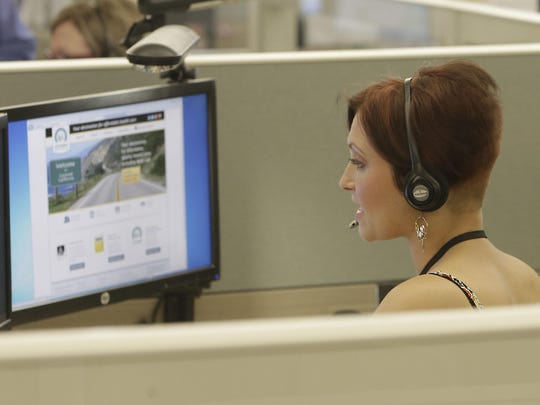"""In this Oct. 1, 2013, file photo, Gina Macaluso, an employee of Covered California, the state's health insurance exchange, provides information at a call center in Rancho Cordova, Calif. California, Kentucky and Vermont had """"significant"""" cybersecurity weaknesses in their state-run health insurance exchanges, federal investigators found, potentially exposing sensitive personal information for hundreds of thousand of consumers."""