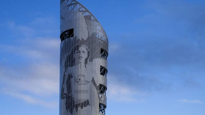 A likeness of Raevyn Rogers joins other track athletes on the side of the tower at the new Hayward Field. [Chris Pietsch/The Register-Guard] - registerguard.com