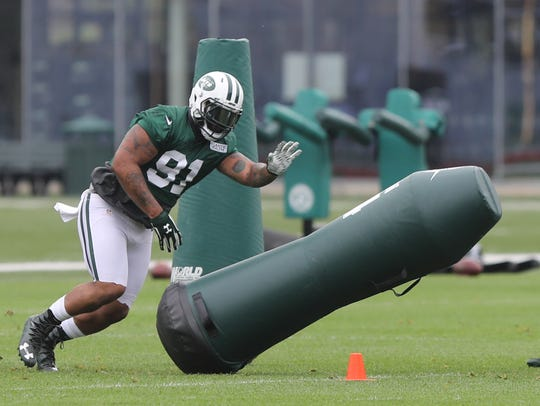 Sheldon Richardson working out with the defensive linemen.