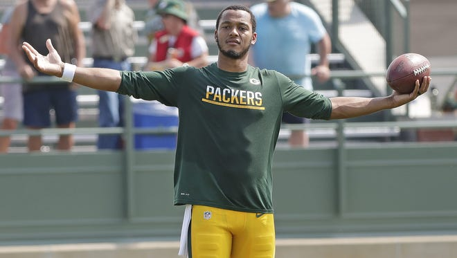 Green Bay Packers quarterback Brett Hundley (7) gestures to a teammate after training camp at Ray Nitschke Field August 30, 2016.