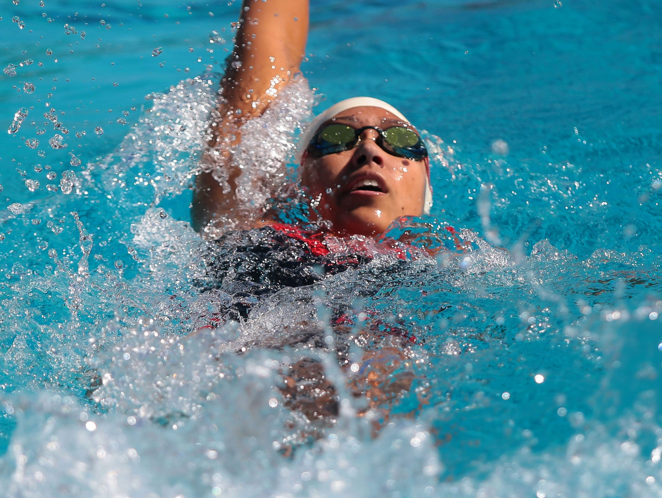 Palm Springs' Christine Hogendyke swims the backstroke in the 200 individual medley as Palm Springs hosts Xavier in a high school swim meet on Monday, April 25, 2016, at the Palm Springs Swim Center.