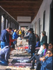 Santa Fe's Plaza is the very pulse of the city with shops and outdoor vendors.