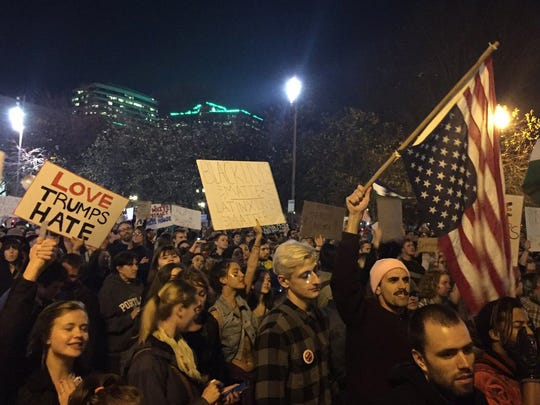 Protesters march on their way to Waterfront Park in