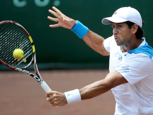 Fernando Verdasco, of Spain, returns a shot to Donald Young in the first set of their quarterfinals match in the U.S. Men's Clay Court Championship Friday, April 11, 2014, in Houston. (AP Photo/Pat Sullivan)