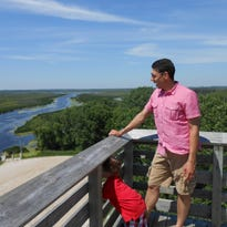 Dan Webber of Hartford, Wisconsin, and his 3-year-old Keller take in the view from Sheboygan Marsh Tower.