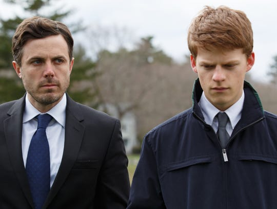 Lee (Casey Affleck, left) must care for his nephew