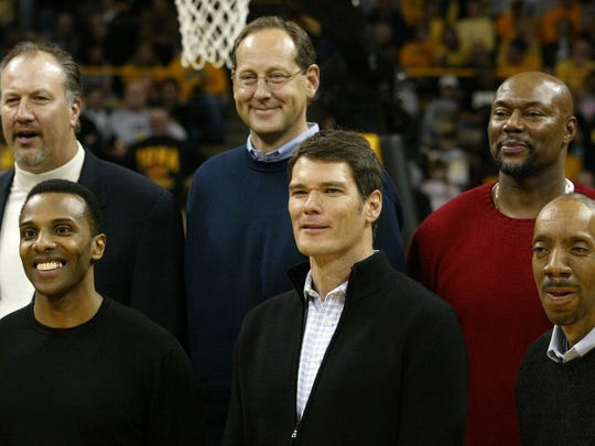 Members of Iowa's 1980 Final Four team are honored at Carver-Hawkeye Arena in 2005. In front, from left, are Ronnie Lester, Jon Darsee and Kenny Arnold, and in back, from left, are Mike Heller, Steve Waite and Vince Brookins.