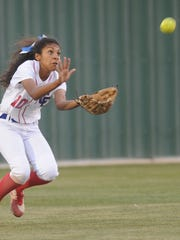 Cooper center fielder Keiana Kemp tries to make a running catch on Kyra Lair's fly ball in the fourth inning. it fell for a hit. Canyon won the Class 5A bi-district playoff game 16-1 Friday, April 28, 2017 at Lady Plainsmen Field in Lubbock to take a 1-0 lead in the best-of-three series.