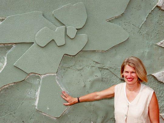 Denver artist Carolyn Braaksma shows off the texture