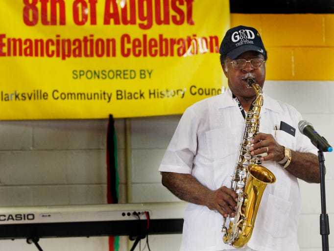 Charles Suggs plays his saxophone during the Emancipation Day celebration held at Burt Elementary School Saturday.