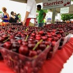 Cherries from Edmondson Orchards are sold near the Open Space during the opening day of the National Cherry Festival in Traverse City on July 2, 2011.