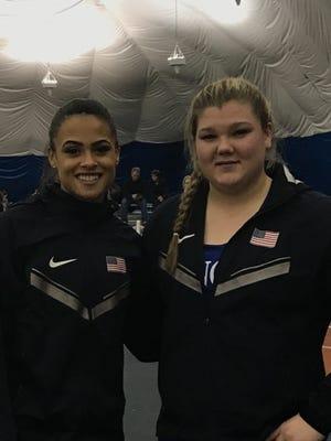 Sydney McLaughlin (left) and Alyssa Wilson wearing their Team USA warm-ups.