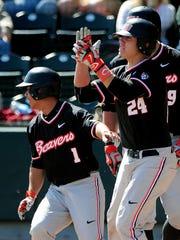 Oregon State first baseman KJ Harrison (24) and second baseman Christian Donahue (1) were impact players as freshmen.