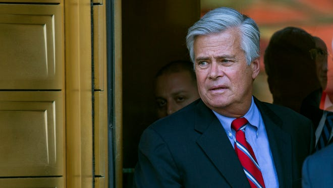 New York Senate Majority Leader Dean Skelos, leaves federal court in New York, Monday after arraignment on charges including extortion and soliciting bribes amid a federal investigation into the awarding of a $12 million contract.