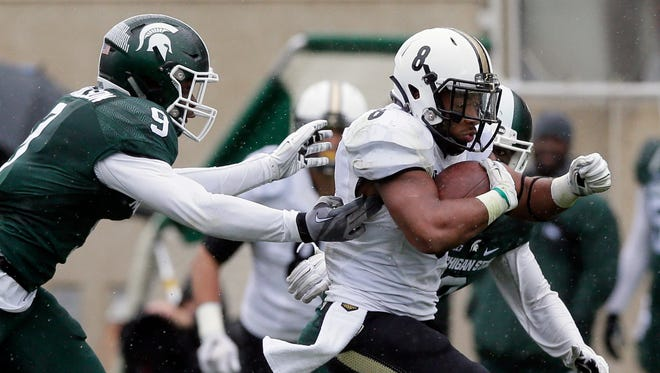Purdue running back Markell Jones (8) pulls away from Michigan State safety Montae Nicholson (9) and cornerback Darian Hicks (2) for a 68-yard touchdown run during the second half of an NCAA college football game, Saturday, Oct. 3, 2015, in East Lansing, Mich. (AP Photo/Carlos Osorio)