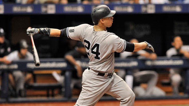New York Yankees' Gary Sanchez hits a three-run homer off Tampa Bay Rays reliever Brad Boxberger during the seventh inning of a baseball game Tuesday, Sept. 20, 2016, in St. Petersburg, Fla.