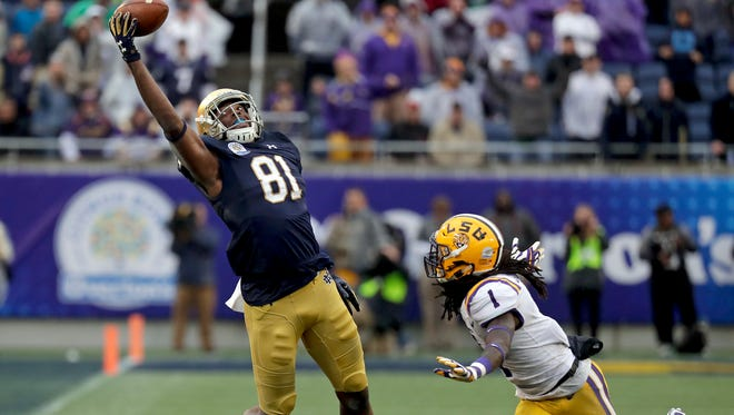 Notre Dame wide receiver Miles Boykin (81) makes a one handed catch in front of LSU defensive back Donte Jackson (1) for a 55-yard game winning touchdown during the second half of the Citrus Bowl NCAA college football game, Monday, Jan. 1, 2018, in Orlando, Fla. Notre Dame won 21-17.