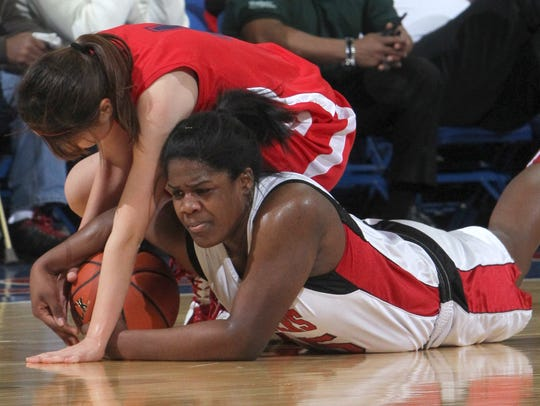 Keio's Mari Oki, left, fights for a loose ball with