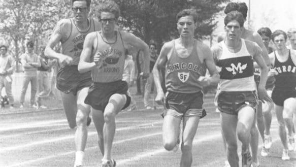Lincoln standout Jim Reinhart (third from left) battles