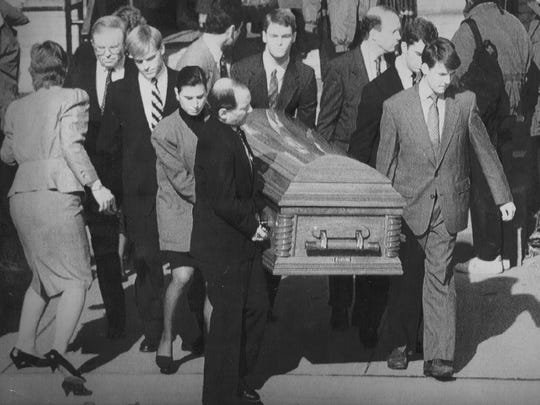A casket bearing the body of T. Anne Cleary, University of Iowa associate vice president for academic affairs, is carried out of St. Patrick's Catholic Church in Iowa City. Cleary was one of five people killed by Gang Lu during a shooting spree on campus Nov. 1, 1991.