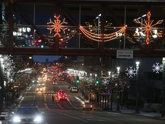 Downtown Rochester is all lit up in festive holiday colors Tuesday night. This view is looking west down East Main Street.