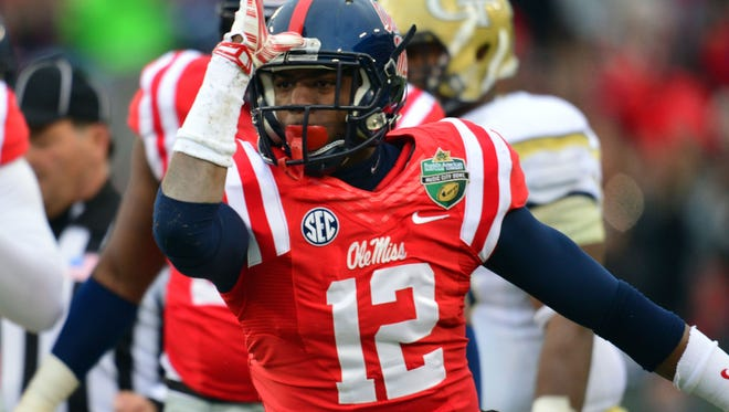 """Mississippi Rebels defensive back Tony Conner (12) celebrates with a """"fins up,"""" signifying a landshark, after a stop against the Georgia Tech Yellow Jackets during the first half at LP Field. The Rebels beat the Yellow Jackets 25-17."""