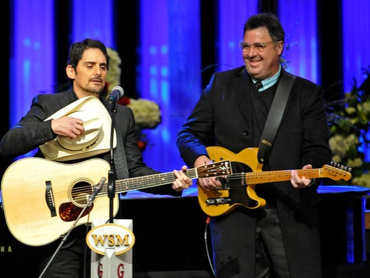 Brad Paisley pays tribute at Little Jimmy Dickens celebration of life service at the Opry House with Vince Gill looking on. Thursday Jan. 8, 2015, in Nashville, TN
