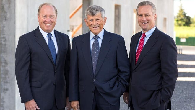 LeChase Construction names William L. Mack ,left, president, and keeps William H. Goodrich, right, as CEO. R. Wayne LeChase (center) remains chairman of the company founded by his family.