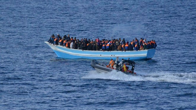 A handout picture provided by the Spanish Defense minister shows a boat carrying 174 migrants as they try to reach Spain from Libya's coast in the Mediterranean sea on Dec. 26, 2015. The ship was rescued by the Spanish Navy.