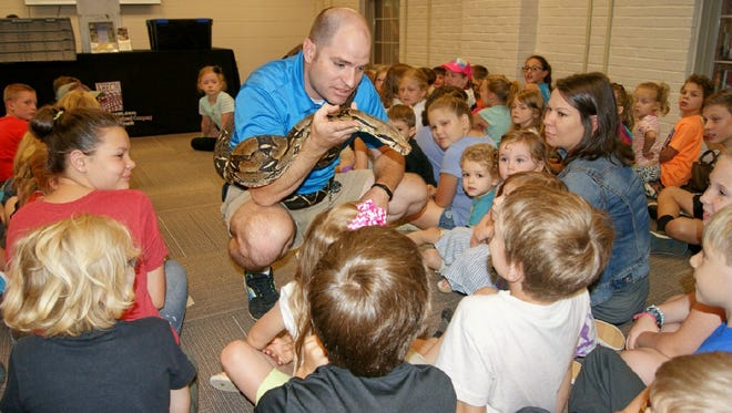 Things have been getting wild at the Fairview Library with the kick-off of the Summer Reading Program which included a visit from Bob Tarter, wildlife biologist with the Natural History Educational Company and his snake.