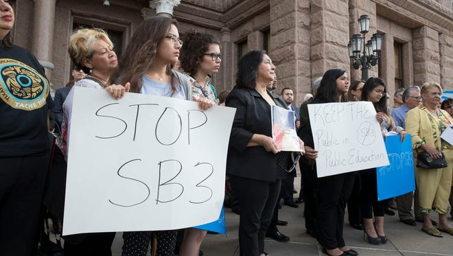 Opponents of Senate Bill 3 — and other proposed school choice legislation — rally on the Texas Capitol's south steps on March 21, 2017.