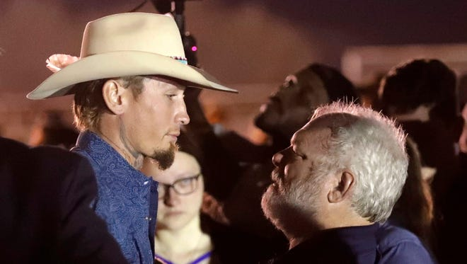 Stephen Willeford, right, and Johnnie Langendorff are hailed as heroes in the shooting in Sutherland Springs, Texas, on Nov. 5, 2017.